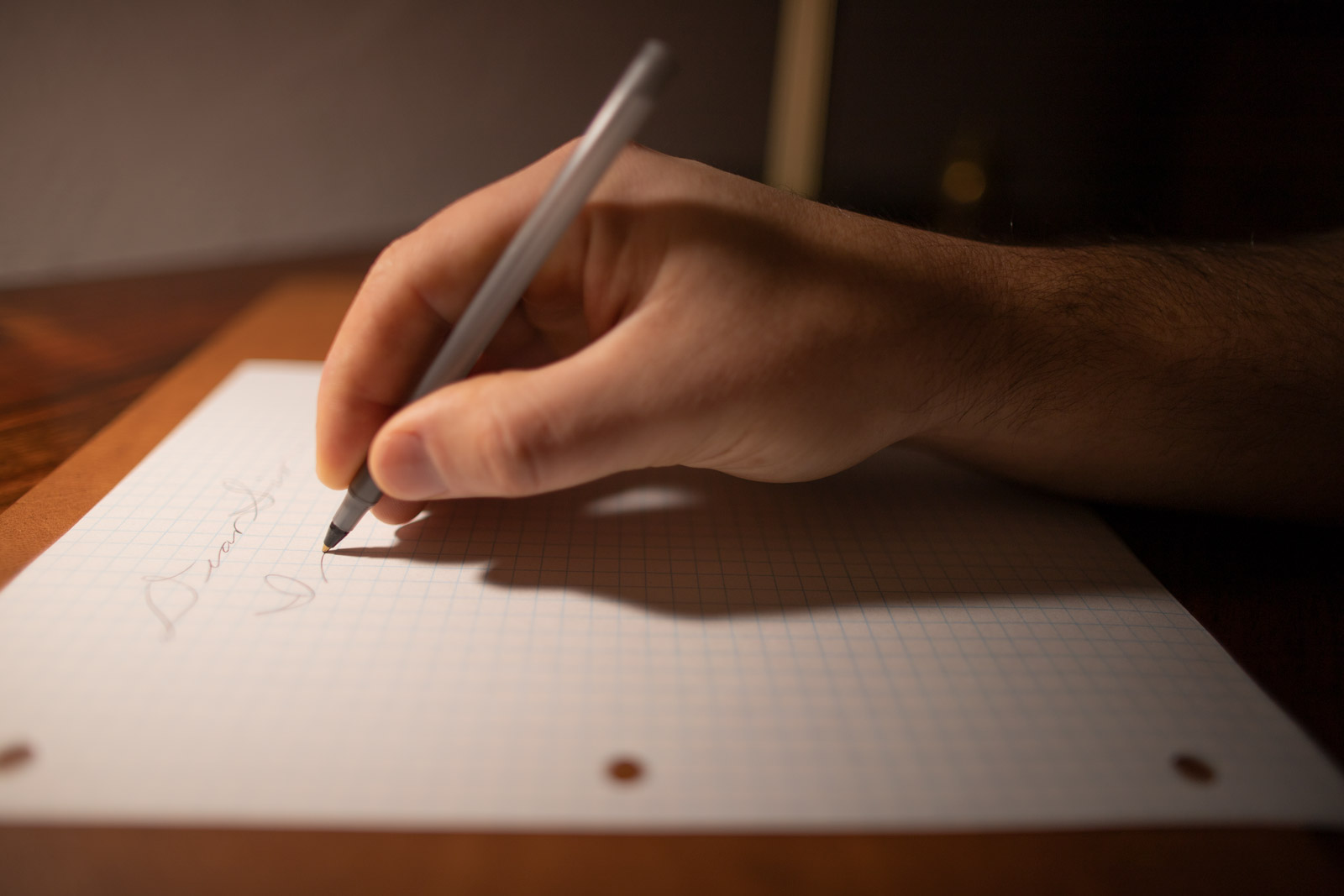 A hand dilligently working to improve its penmanship